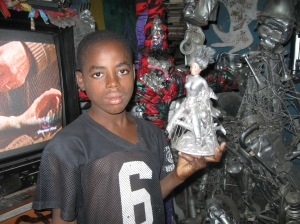 A young artist with his creation